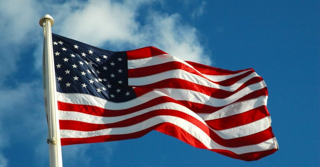 This image has an empty alt attribute; its file name is american-flag-wind-3-1024x536.jpg